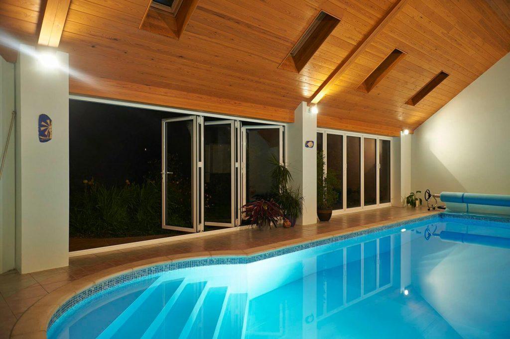 aluminium bifolds next to swimming pool